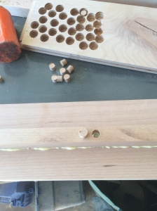 The mattress supports glued and screwed to the inside of the rails and plugged with tapered face grain plugs of the same species.