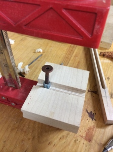 Pressing the insert into the hole.