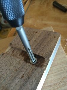 Tapping the aluminum dowel insert.