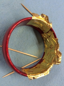 Gilding with gold leaf.